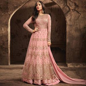 Desiring Peach Colored Partywear Embroidered Netted Anarkali Suit