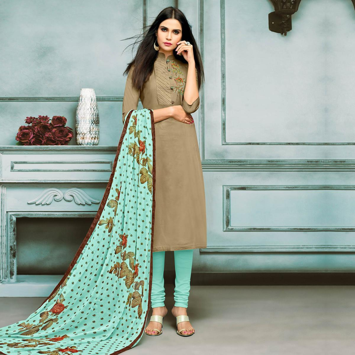 Unique Chiku Colored Partywear Embroidered Chanderi Silk Suit