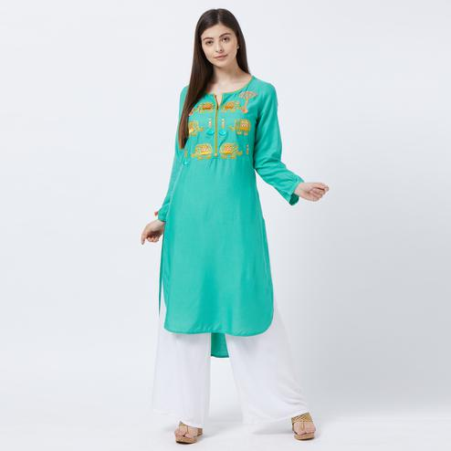 Amazing Turquoise Green Colored Partywear Embroidered Rayon Long Kurti